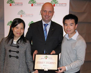 Angela Chua, Marcel de Bruin and Eric Kwan proudly display their award certificate (from left to right)